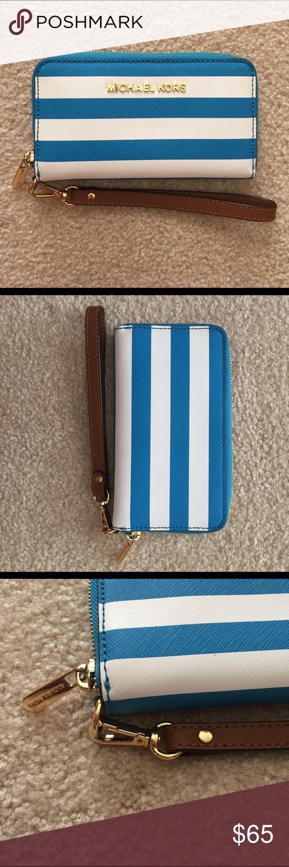 New Michael Kors Wristlet/wallet Aqua blue and white striped Michael Kors wristlet/wallet. Perfect condition, new without tags. Never used. Pet free smoke free home. MICHAEL Michael Kors Bags Clutches & Wristlets