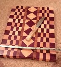 End grain using exotic wood featuring Bobinga, Zebra , purple heart, hard maple. Multiple coates food safe oils and caranuba wax for durability. Inticate design weeks to complete wood costs alone over $100.00 Anthem or Glendale for pick up can make custom size or wood options for less expensive options .