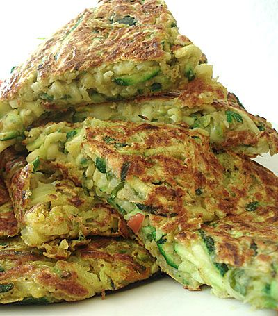 Zucchini and chickpea pancakes        3 medium zucchini, or about 4 cups shredded      2 zucchini flowers (optional; adds a bit of color)      Some coriander or basil leaves (optional: adds flavor)      1 cup chickpea flour      1 tsp. salt      1 tsp. garam masala      1/2 tsp. hot red chili powder      1/2 tsp. curry powder      Olive oil for cooking
