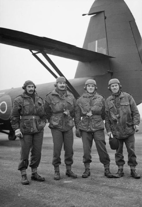 Glider pilots pose in front of a Horsa glider 11 December 1944.