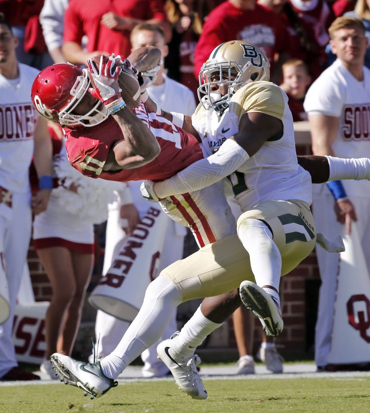 Oklahoma's Dede Westbrook (11) scores on a catch defended by Baylor's Henry Black (6) during the second half of a college football game where the University of Oklahoma Sooners (OU) defeated the Baylor Bears (BU) 45-24 at Gaylord Family-Oklahoma Memorial Stadium in Norman, Okla., on Saturday, Nov. 12, 2016. Photo by Steve Sisney, The Oklahoman