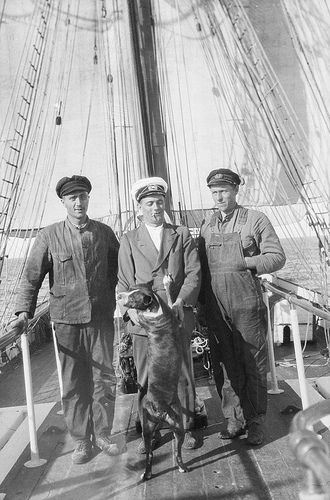 Second mate, the Master, the First Mate and the ship's dog, on board the 'Grace Harwar'. 1929. National Maritime Museum.