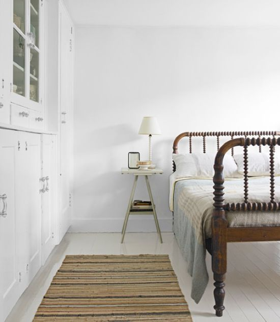 white with spindle bed - I want that bed. There is something appealing about minimalist yet the linen bedspread, warm wood and soft color save it from being cold. You just know that linen coverlet is soft and inviting.
