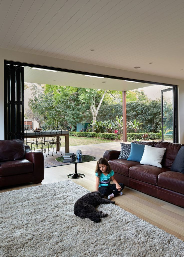 Living room opens to deck and garden beyond — Bijl Architecture