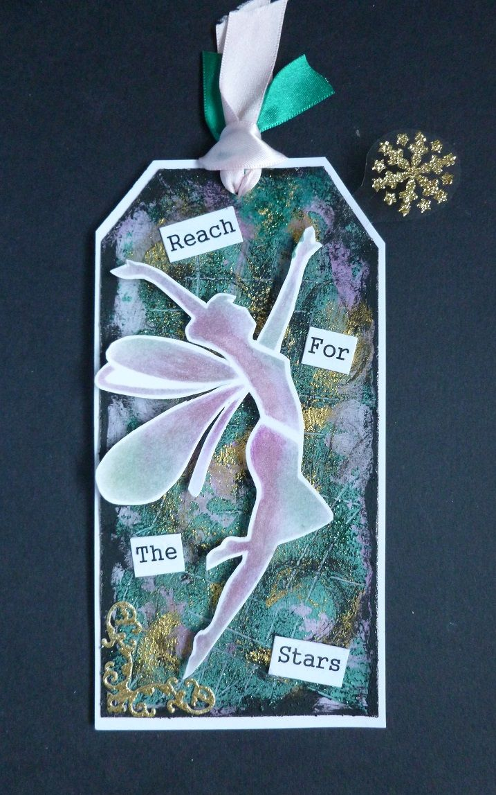 'Reach For The Stars' Tag - Imagination Crafts - White gold & Antique Pink Starlight Waxes.  Hunter green & Gold shine Sparkle Mediums.  Soot, Duck egg & Verdigris Rusty Patinas.  Star touch fairy stencil.  Magi-bond glue.  Distress inks. Tattered Lace corner die.  March 2017.   Designed by Jennifer Johnston.