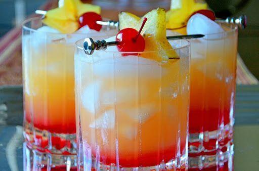 Limoncello Sunrise With Orange Juice, Limoncello, Ice, Grenadine, Cocktail Cherries, Orange Slices