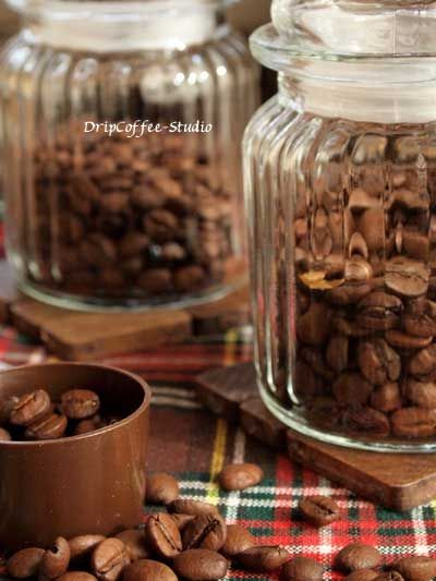 Placing different coffee beans in glass canisters