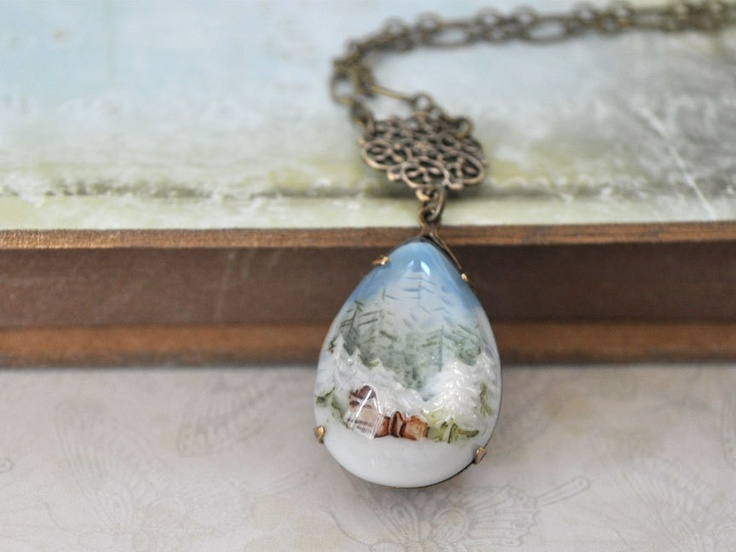 SNOW GLOBE, vintage style hand painted forest and snow resin pear shaped necklace in antique brass. $27.50, via Etsy.