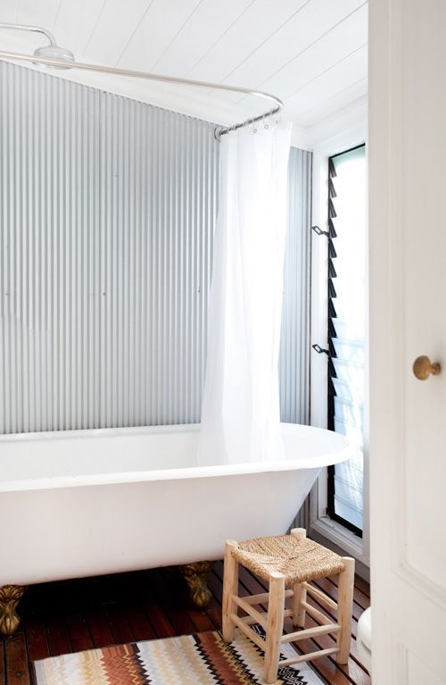 AndreaMillar-bathroom - Zincalume mini-orb sheeting is being used in bathrooms as a great contrast texturally and visually to white tiles. It's also really cost effective.