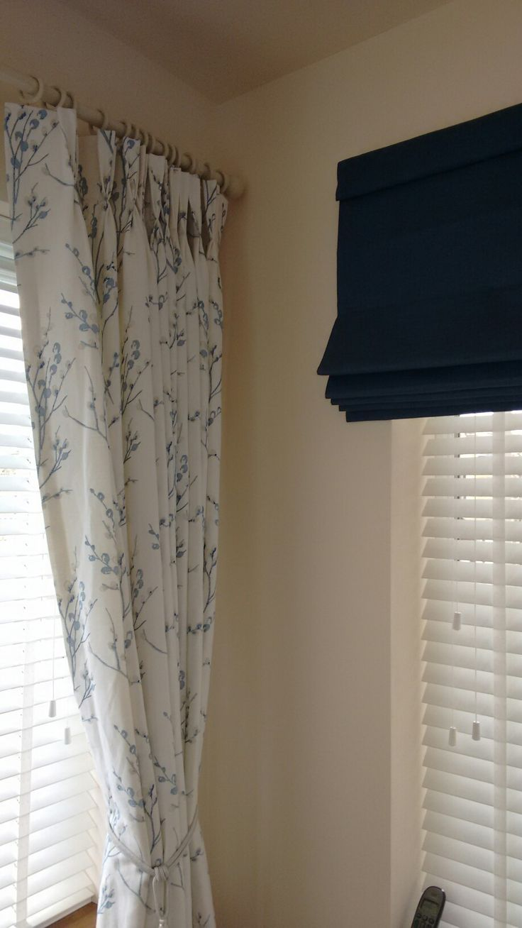 Pinch pleat curtains, Roman blind and Venetian blinds
