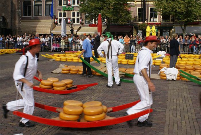 This ritual consist out of cheese markets, which are being located in Alkmaar, Edam, Hoorn, Gouda, and Woerden. There are all kind of stands which are selling cheese and wooden shoes (klompen). The main event is the cheese carrying which you see on the picture.