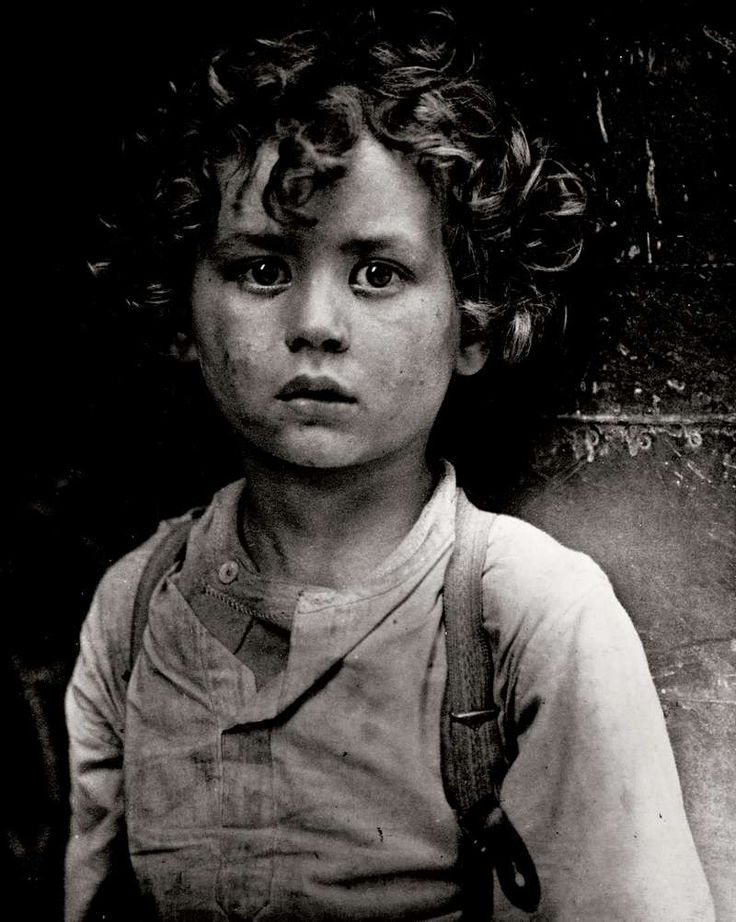 by Lewis Hine. The boys facial expression says so much about what he has seen in life and he stares directly at the camera, setting the mood of lost innocence and sadness.  http://next.liberation.fr/arts/11011685-lewis-hine-pionnier-de-la-photographie-sociale