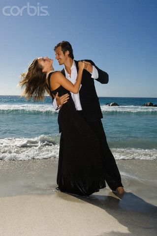 Elegant Couple Dancing on Beach