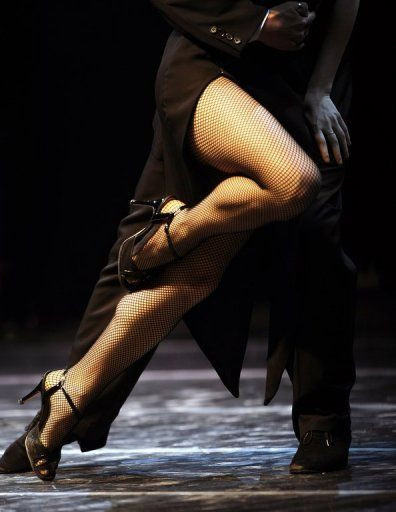 An Argentine couple dance during a semi-final at the Tango Dance World Championship in Buenos Aires on August 28, 2010. Some health centers in Buenos Aires are finding tango can help mental wellbeing.