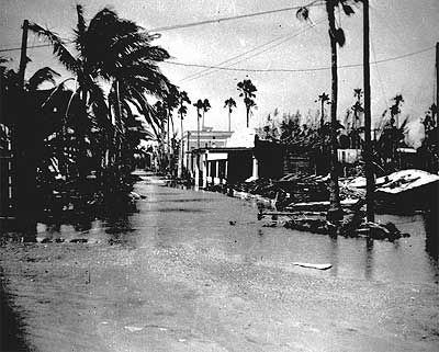 Tidal flooding in Everglades City is pictured two days after the passage of Hurricane Donna. Flooding was six to seven feet deep at peak tide, according to caption information from the Florida State Archives. Hurricane Donna roars across South Florida with an 11-foot storm surge, 150 mph winds and more than $300 million in damage. 13 people are dead and 51% of FPL's customers are without electric service.