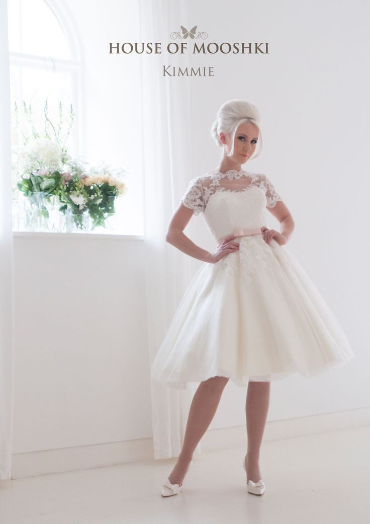 Short tea length tulle and lace wedding dress with short sleeves