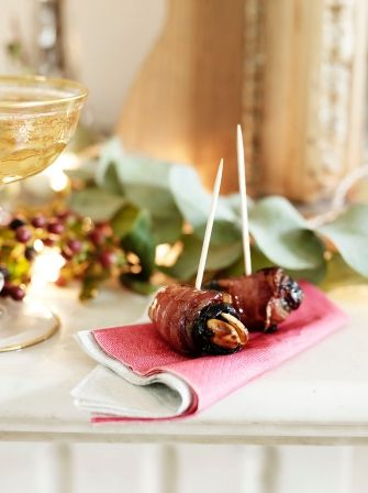 Devils on Horseback  (Jamie Oliver) - - -  24prunes ; 24 blanched whole almonds ; extra virgin olive oil ; 12 rashers of smoked streaky bacon .   Destone the prunes & make a small an incision. Season the almonds with sea salt & drizzle with oil, then stuff inside the prunes.  Halve the rashers of bacon across the middle, then wrap each prune in a piece. Place the devils on a lined baking tray, cover and chill until ready to cook. Cook in oven 15-20 mins at 190ºC/gas 5.