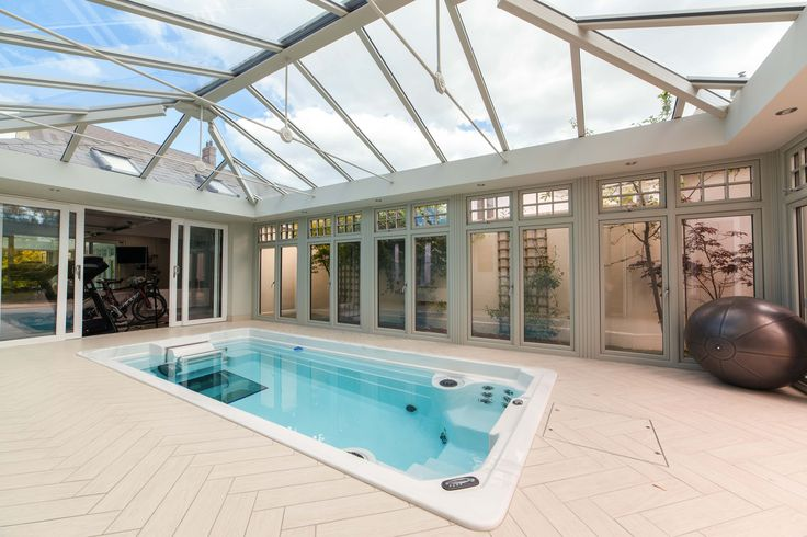 Photo 2 of 5 featuring the Endless Pool swim spa in a beautiful glass conservatory.  Build your own swim spa with our online configurator and explore the possibilities for your space: http://www.endlesspools.com/swim-spa-prices.php