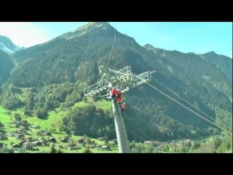 film of construction of the new cable car with huge Swiss helicopter