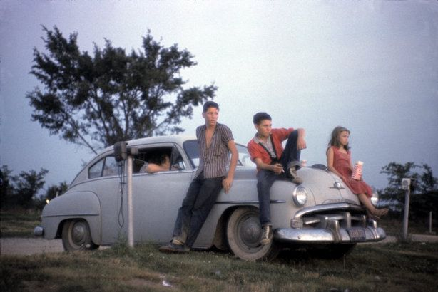 ORINDA, Calif.—Sitting on the hood of a car at a drive-in, 1960.  Today's Pictures: Two Thumbs Up