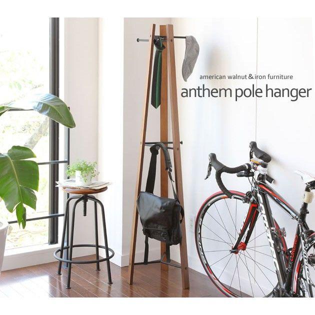 ポールハンガー/木製/おしゃれ/コートハンガー[材質]:天然木化粧繊維版(アメリカンウォールナット材)、スチール[カラー]:ブラウン[サイズ]:W420×D405×H1650mm[生産国]:台湾[組立て]:組立品[特徴]:木とスチールがうまく融合したおしゃれなデザインのハンガー。毎日使うバッグ、帽子、ストール、ベルト、ネクタイなど小物をさっと掛けられて便利です。目を引くデザインでおしゃれ度UP!普段目にする家具だから、見た目のデザインにもこだわりたい方におすすめです。※他の商品とは同梱出来ません。 コートハンガー ハンガーツリー ハンガー ラック コート ポールハンガー 木製 おしゃれ バッグ 収納