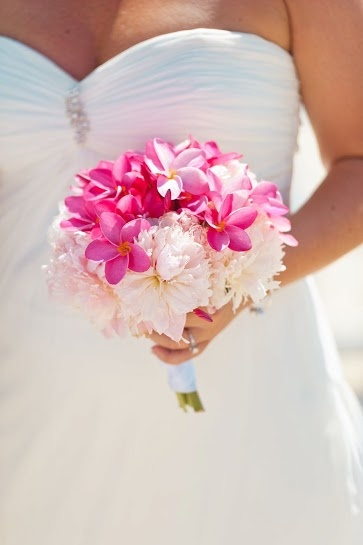 Bahamas Wedding Beach - Pink peonies and frangipani wedding bouquet Photo by / Lyndah Wells Photography. Chic Bahamas Weddings