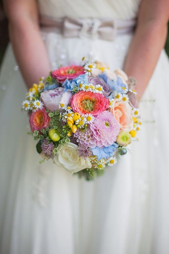For a vintage wedding, go with a structured bouquet filled with a range of pastel blooms.     Image via  Love My Dress.