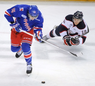 Kitchener Rangers' Ben Thomson takes the puck off Saginaw's Dylan Sadowy and gets a breakaway Friday night at the Aud.
