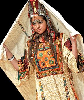 A Jordanian model show off traditional dress and head dress during a Jordanian Culture even