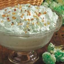 Pistachio Fruit Salad:  1 3-oz. box instant Pistachio pudding mix; 1 8-oz. carton Cool Whip; 1 large can crushed pineapple, undrained; 1/2 to 1 cup chopped pecans or pistachios; Mini Marshmellows. Preparation:  In a bowl, combine pudding mix and pineapple (with juice), nuts and marshmellows mix & refridgerate. Yum.