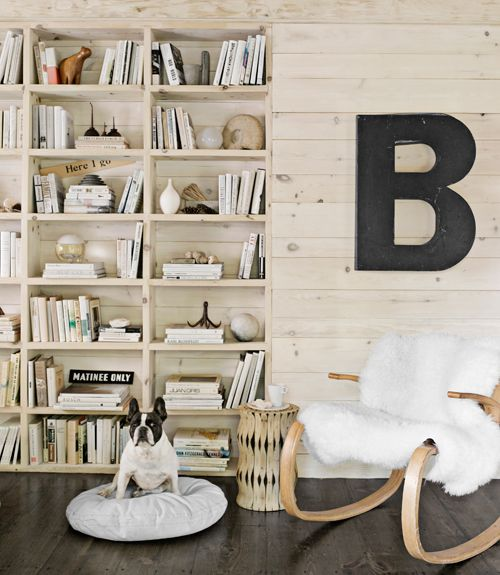 built-in bookshelves + vintage bentwood chair via Country Living