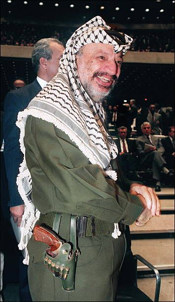 Yasser Arafat chairman of Palestine Liberation Organisation shown in a picture dated 04 September 1989 in Belgrade wearing his famous gun grins as he...