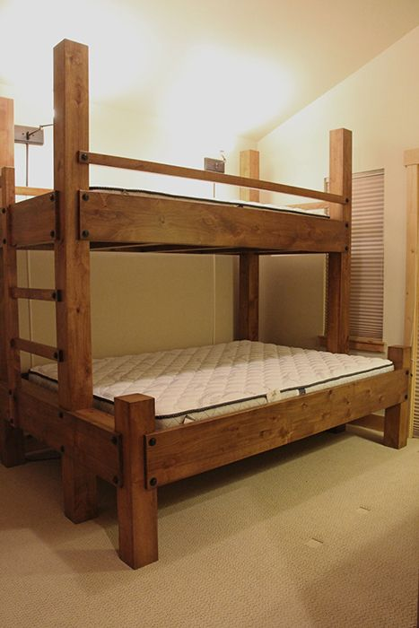 Twin Xl over queen bunk bed with integrated ladder. Shown with low front posts.