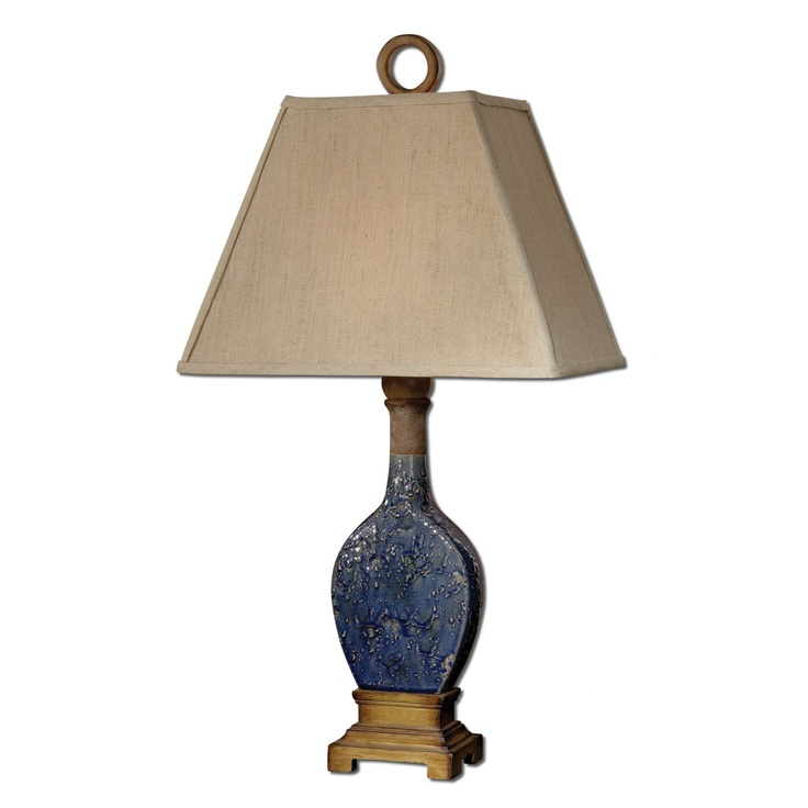 We just installed this amazing blue ceramic lamp with reclaimed wooden finial in a living roomwhere there is no other blue in the room at all.... well at least until the art is installed... it is these little out of the box details that truly make a house a home.