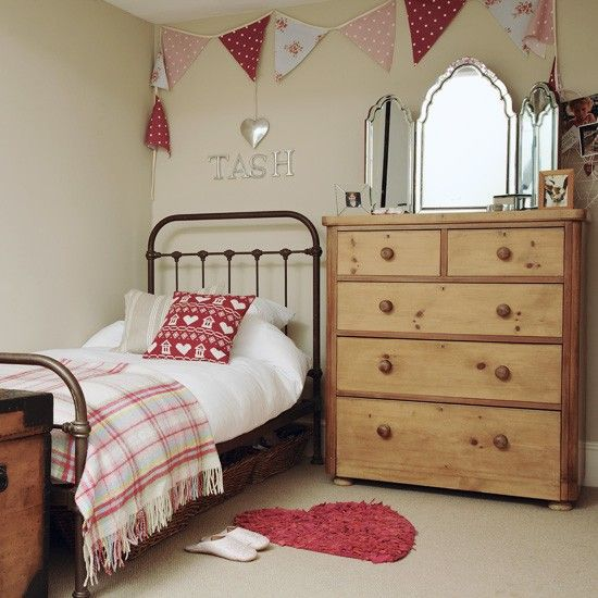 **Flag banner for Nate's room??** Young girl's bedroom Red and pink accessories in a variety of patterns from floral to checks give this bedroom a country cottage feel. Bunting adds a fun element to the room.