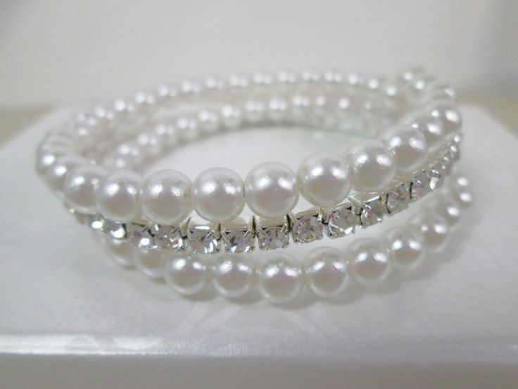 A personal favorite from my Etsy shop https://www.etsy.com/ca/listing/265141832/white-pearl-bridal-cuff-bracelet-multi