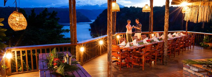 PNG : Tufi Dive Resort - perched on a cliff top terrace overlooking Tufi Harbour, this boutique resort has panoramic views of the sea, fjords and mountains. The deluxe bungalows have polished timber floors and the walls are lined with traditional woven material. Bungalows from $160 per night (from Get Lost magazine).