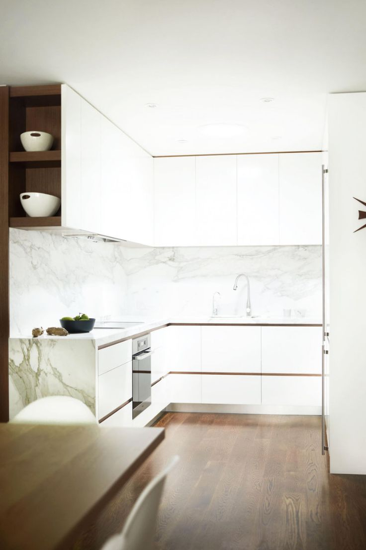 White kitchen with marble backsplash