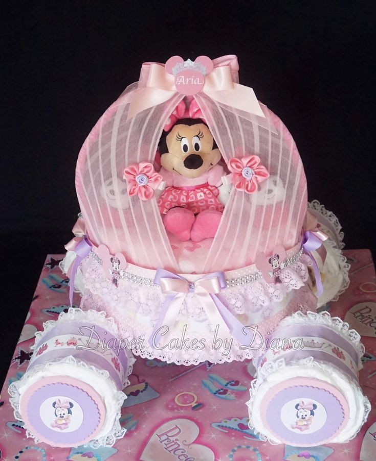 Minnie Mouse inspired princess coach/carriage diaper cake. www.facebook.com/DiaperCakesbyDiana