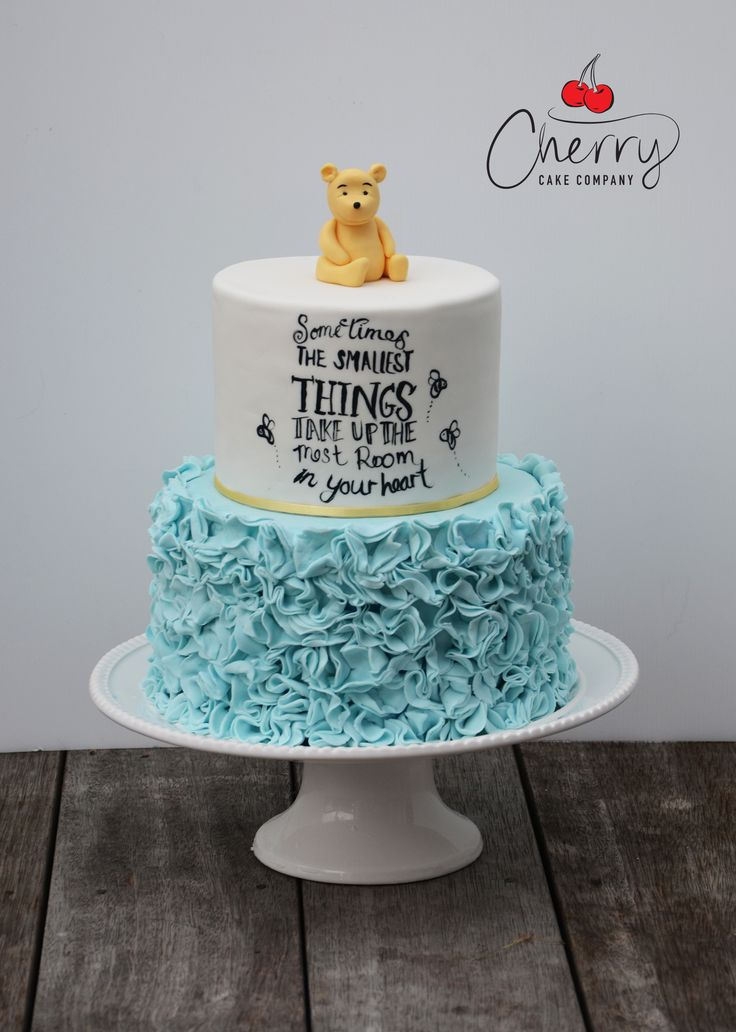 cute winnie the pooh baby shower cake with ruffles