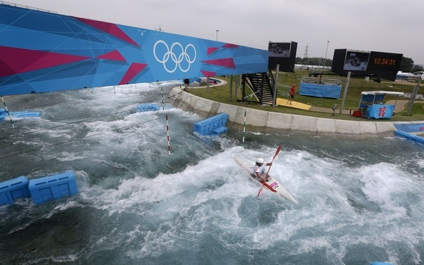 Caroline Queen, of the United States, trains for the women's K1 kayak slalom at the Lee Valley White Water Center ahead of the 2012 Summer Olympics, Friday, July 27, 2012, in London. (AP Photo/Victor R. Caivano)-what a cool lookinig venue!!
