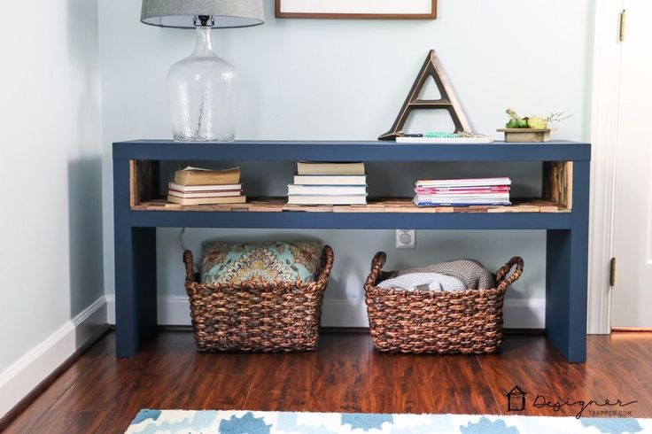 This is such an easy project and the end result is a very high-end look on a very tiny budget.  I fell in love with a $900 bookcase that I couldn't afford.  It…