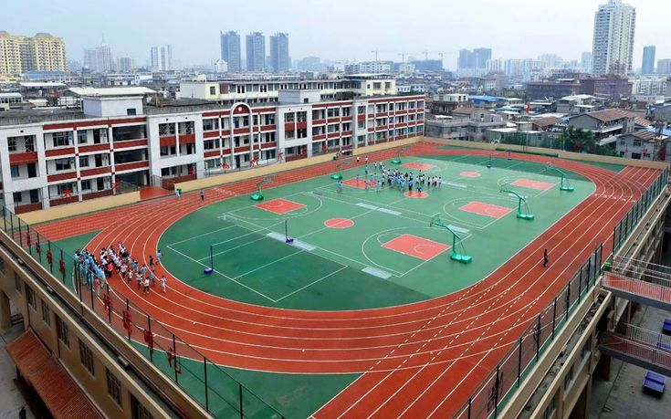 A playground is seen on the roof of a school in Putian City, southeast China's Fujian Province. The playground includes three basketball courts, two volleyball courts and a 200 meter running track. The school says the rooftop playground solves the problem of their limited space.