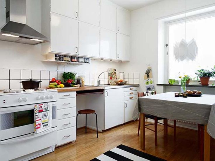 rustic kitchen small space with white tile backsplash and cabinet storage also wooden dining sets beside window