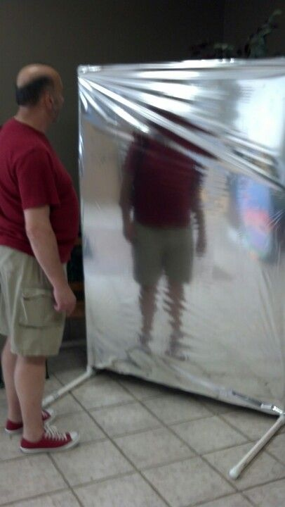 Fun house mirror from a PVC frame and mylar paper.