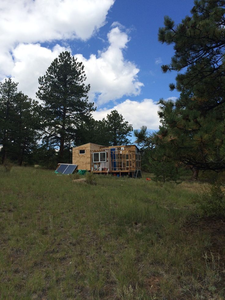 Tiny house is built on a trailer with wheels, but is currently attached to a porch. Tiny house itself is approx 140 sq ft but including the porch it is 420 sq ft. Beautiful mountain views and a year round natural spring! In the spring and summer there is a pond where lots of frogs…