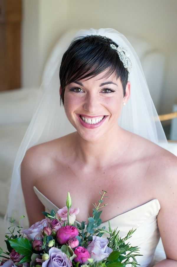It doesn't get more classic than a veil. Pair your pixie cut with a voluminous veil and glam hair clip. Wear with a simple necklace or pair of earrings and consider yourself well-accessorized!