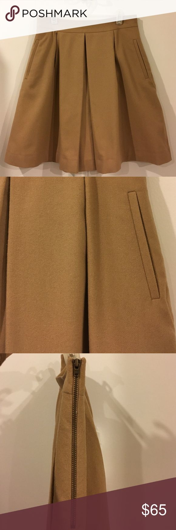 Massimo Dutti wool skirt Stunning classic A-line wool skirt from Massimo Dutti. Only worn a few times and still feels brand new. Flared with side zip fastening and full lining. Great addition to any closet as the temperature drops! Pairs great with tights and heels or with boots. Massimo Dutti Skirts Mini