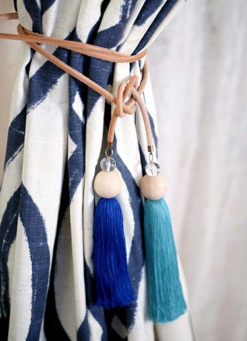 tassel curtain tie backs. Great idea, using tassels to coordinate with the room decor.