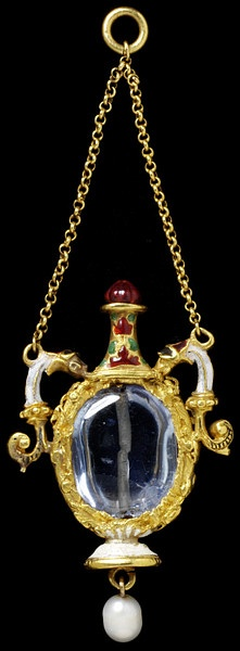 Enamelled gold pendant in the form of a flask, set with a sapphire and hung with a pearl. Western European, mid 16th century